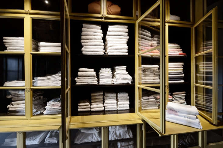 located off the laundry, a luxe linen closet hasglass fronted, lacquered pine 24