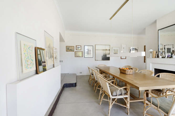 The dining room is characterized by concrete resin floors and unpainted plaster walls. Photograph by Katrin Vierkant, courtesy of LSL Architects. (For more on concrete, see our postRemodeling loading=