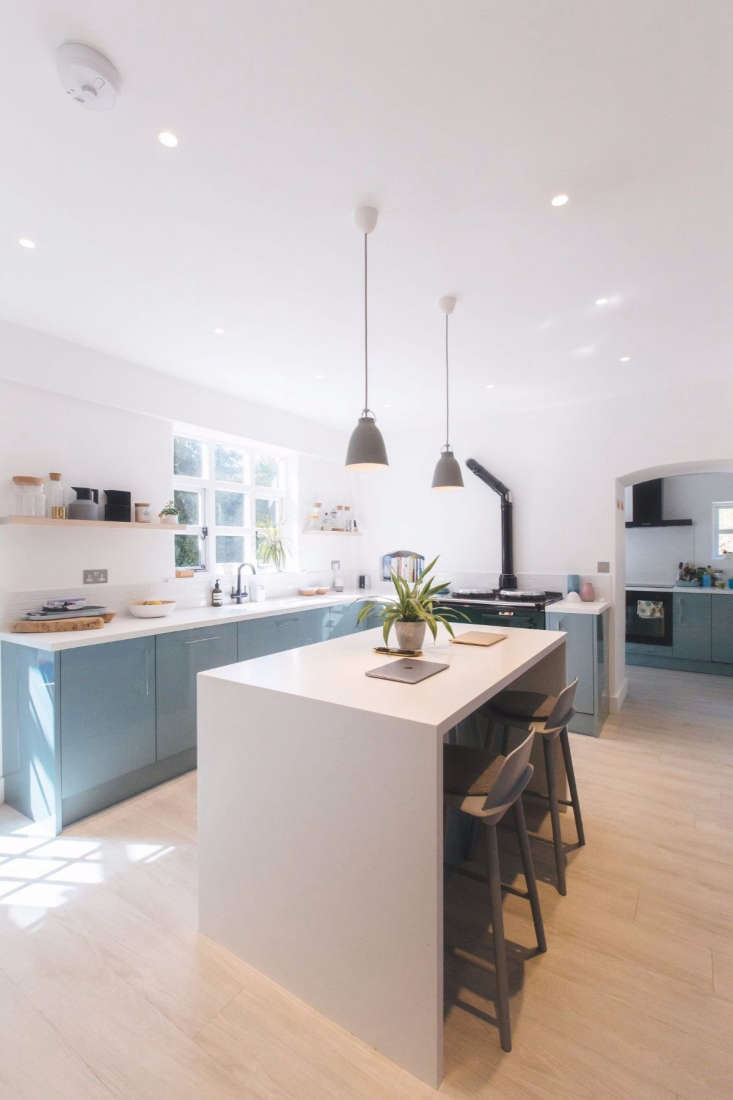 light wood floors white island blue cabinets kitchen awards uk