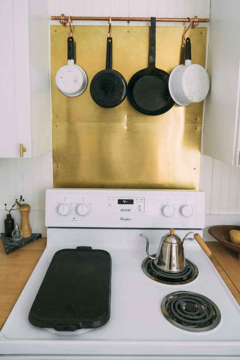 A simple DIY upgrade: a brass backsplash.