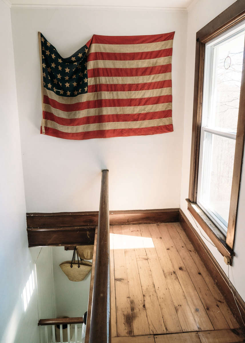 A flag, a vintage find that Przystup thinks she found atStella Dallas Living in Williamsburg, Brooklyn, hangs above the stair landing.