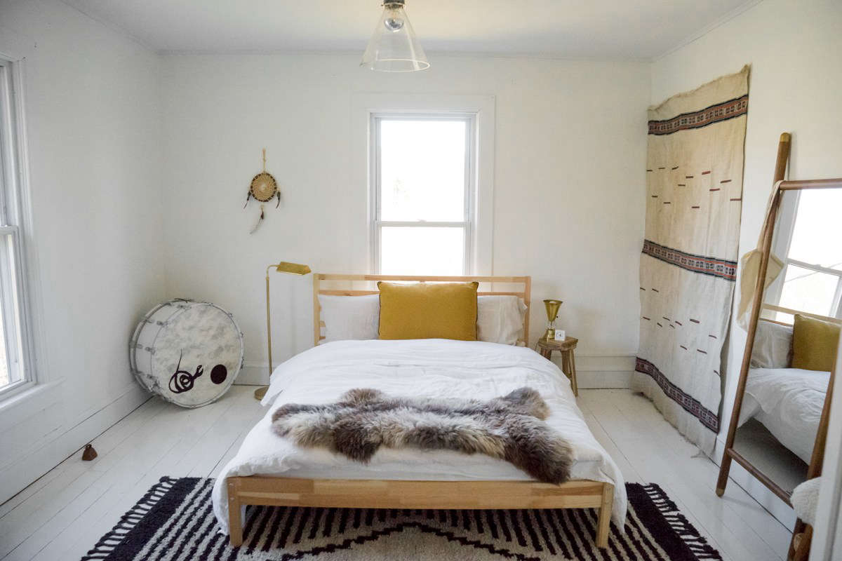 A bright bedroom with high/low finds.