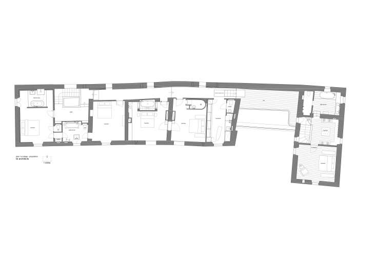 the second floor is divided into six bedrooms, each with its own bath, plus the 26