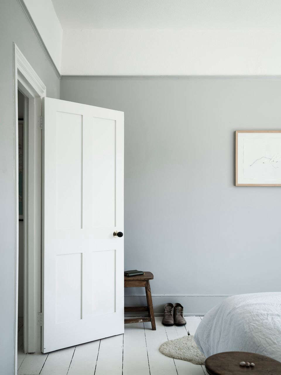 The bedroom is painted in the palest gray of any room in the house; it&#8