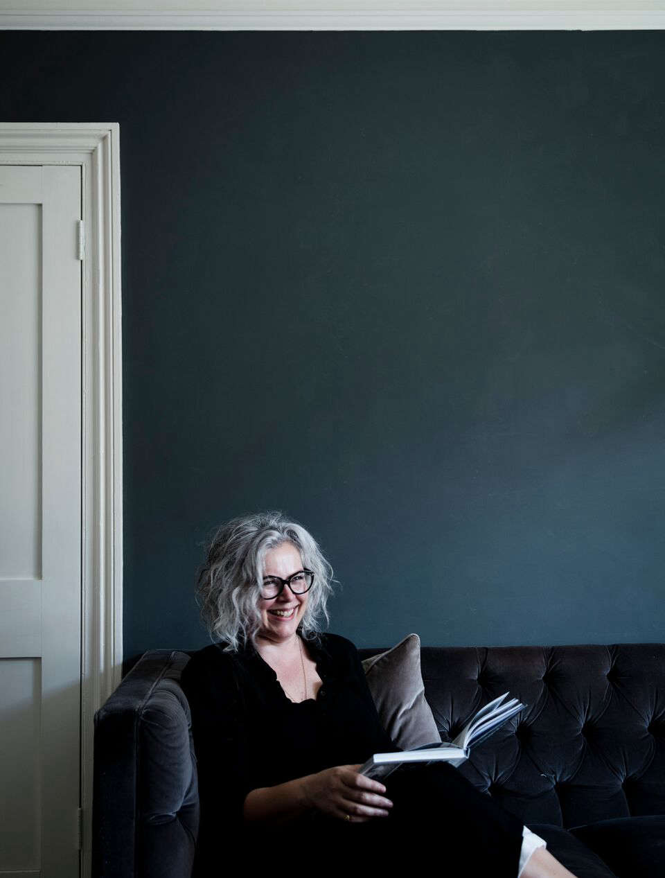 Kate in her dramatically toned sitting room.