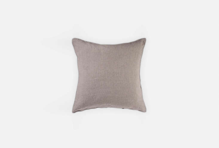 The Merci Pink Beige Pillow Case Hiyoko can be used as a seat cushion as the designers did in this dining room; $44.45 at Merci.The Washed Linen Pale Sage Cushion is another option for loading=
