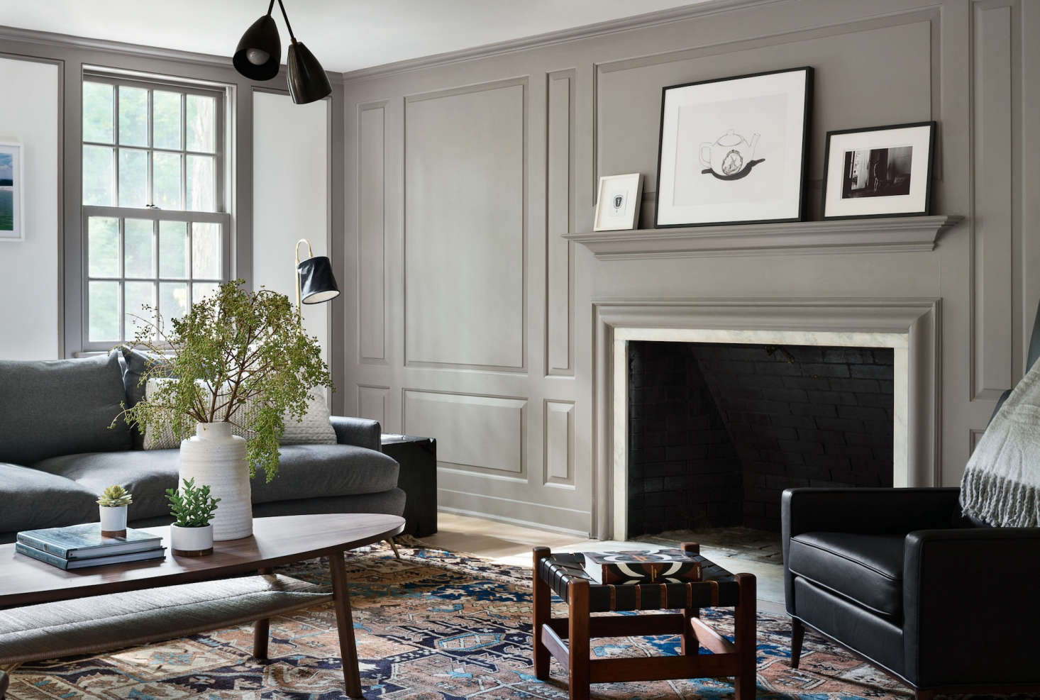 In this Bedford, NY, home, a millwork wall, painted Farrow & Ball's Charleston Gray, adds a bit of lofty elegance, without overwhelming the space. (See Architect Visit: A Renovated Farmhouse in Bedford with Scandinavian Influences.) Photography by Amanda Kirkpatrick, courtesy of Rafe Churchill; styling by Anna Molvik.