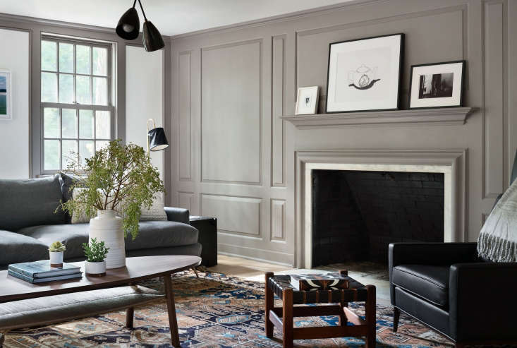 In this Bedford, NY, home, a millwork wall, painted Farrow & Ball'sCharleston Gray, adds a bit of lofty elegance, without overwhelming the space. (SeeArchitect Visit: A Renovated Farmhouse in Bedford with Scandinavian Influences.) Photography byAmanda Kirkpatrick, courtesy of Rafe Churchill; styling byAnna Molvik.