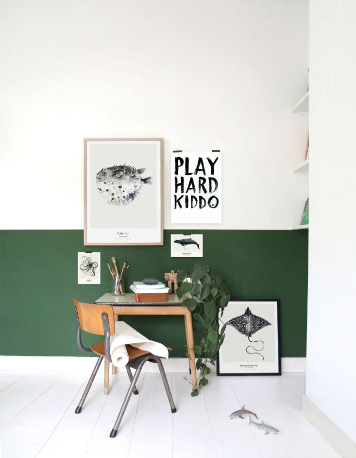 The desk wall is set off by a band of dark green; all else is painted white. The Spotted Eagle Ray and other prints are all by Koster.