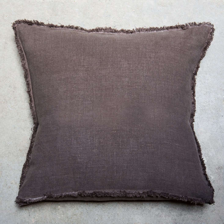 The fringed Toogood Linen Oxford Cushion, shown here in rich brown, is available in four colors; €58 ($68).