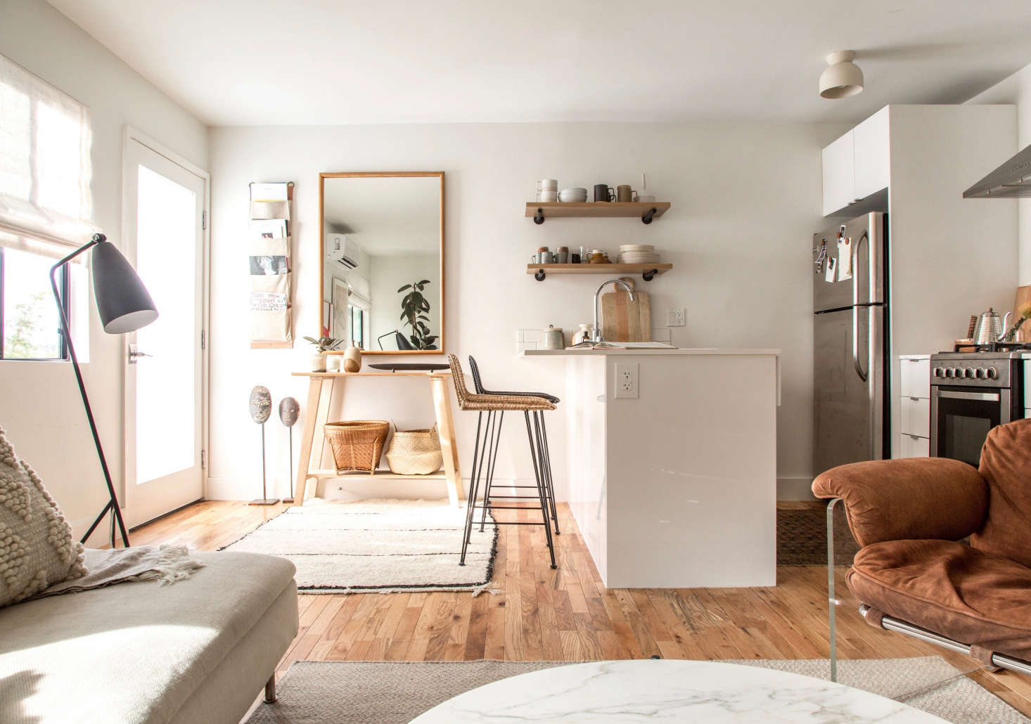 A single-door fridge fits into a built-in niche (with room to spare) inThe LA Rental, Upgraded: Designer Paige Geffen's 500-Square-Foot Challenge.