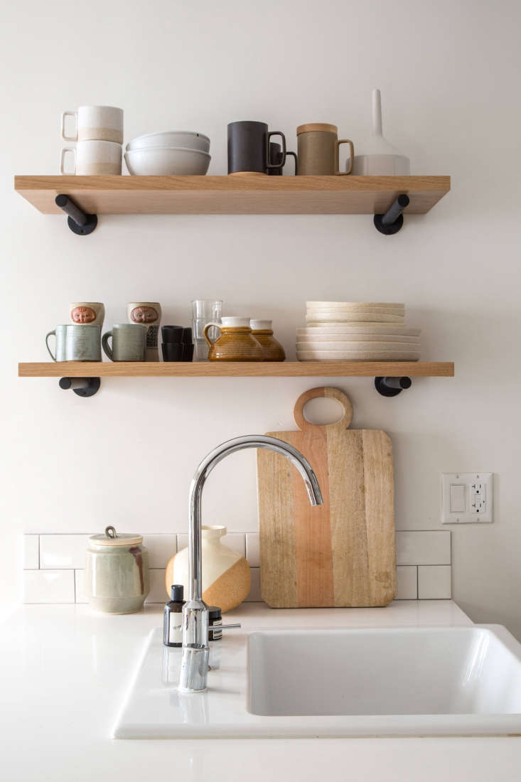 a single bowl sink fits the small space kitchen of an la apartment; see the la  10