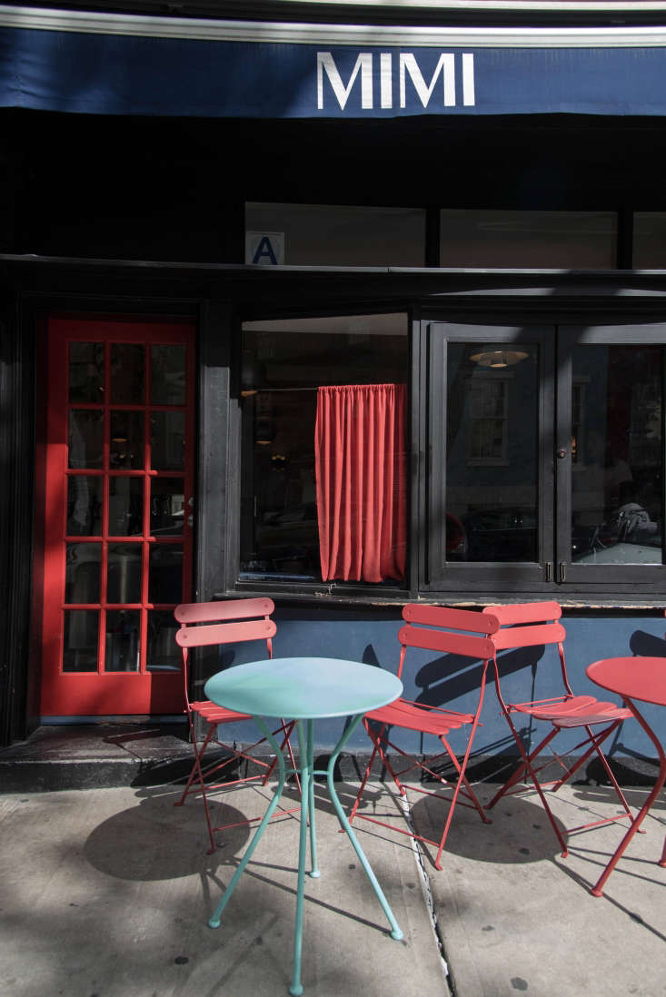 outside, a manhattan sidewalk is transformed into a charming dining area thanks 24