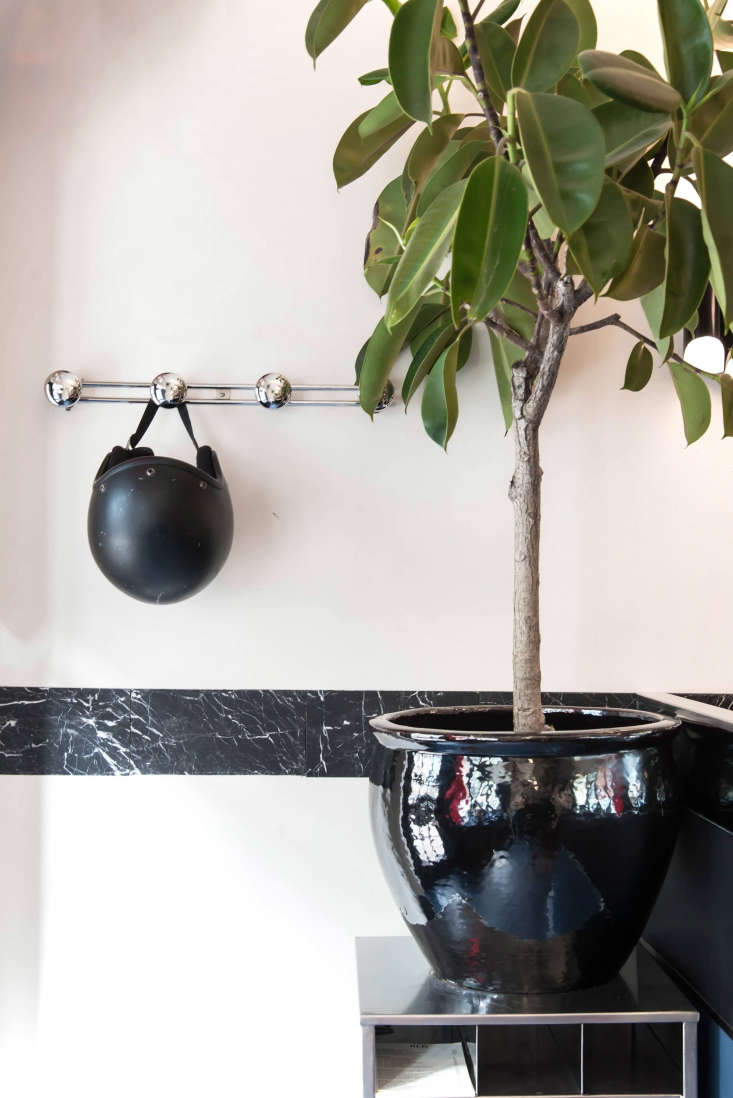 by the door: hooks for easy coat storage and a motorcycle helmet (courtesy of f 23