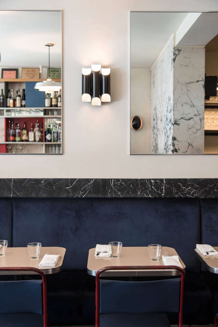 """The idea that started it all: using marble as trim, as seen lining the banquettes at Mimi in New York City. Instead of maxing out the budget for the small bistro, the team used marble as an accent: """"We found a lot of images from Vienna and France where marble was used instead of wood. This gave us the general concept of using marble as an outline, because we couldn't afford to have the entire bar or floor be marble."""" Read on inFrench Glam on a Budget:  Ideas to Steal from Mimi, New York's Sexiest Bistro."""
