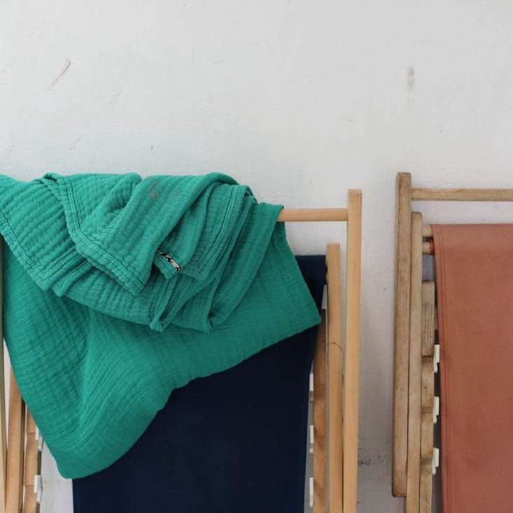 VintageInspired Furniture Reimagined in Color The Copertina Throw, shown in Green (also available in Yellow, Olive Black, and Sienna) is a soft, lightweight cotton gauze blanket made in Portugal; €49 to €95 (\$56 to \$\108).