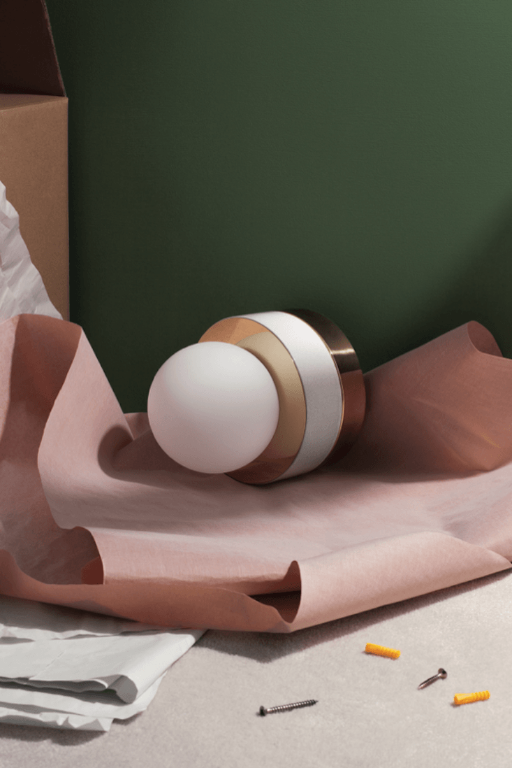 VintageInspired Furniture Reimagined in Color The Small White Wall Light was designed by the Socialite Family in collaboration with lighting company HAOS. It&#8\2\17;s made of matte opal glass, white ceramic, and brass for €450 (\$5\15). It&#8\2\17;s also available in black.