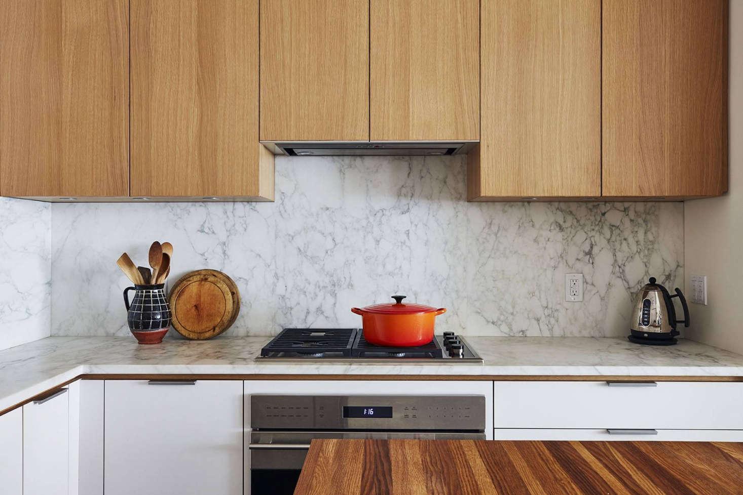 Appliances include aWolf 30-Inch E Series Transitional Built-In Oven, aWolf 30-Inch Transitional Gas Cooktop, and aFuturo 3