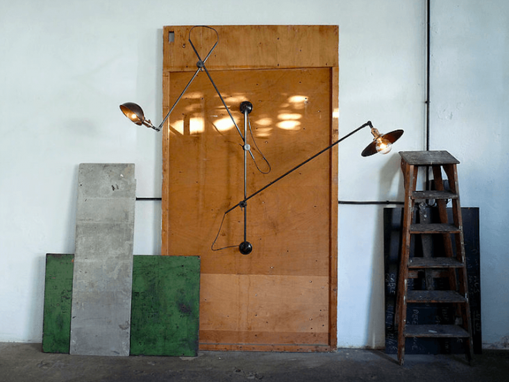 From Wo & Wé, which designs and makes itslights in a workshop in Lyon, France, comes the Adjustable Three Arms Wall Lamp in black patinated steel for €859 ($985 USD) at Wo & Wé.
