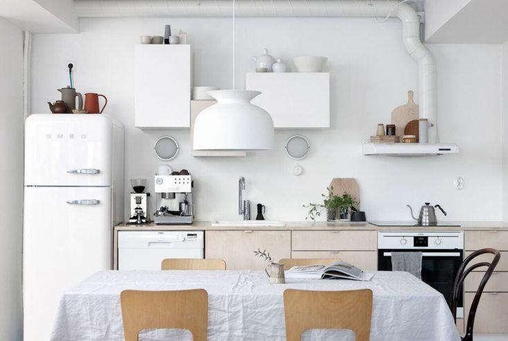 A simple white Smeg in the Helsinki kitchen of Finnish interiors and prop stylist Anna Pirkola. SeeKitchen of the Week: A Stylist's $3,400 Kitchen Makeover, DIY Scandi Edition.