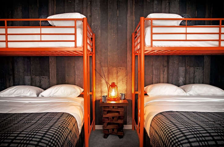 Steal This Look CampStyle Bedroom with Bold Color Two sets of bunk beds in the hotel&#8\2\17;s Explorers Club room sleep eight.