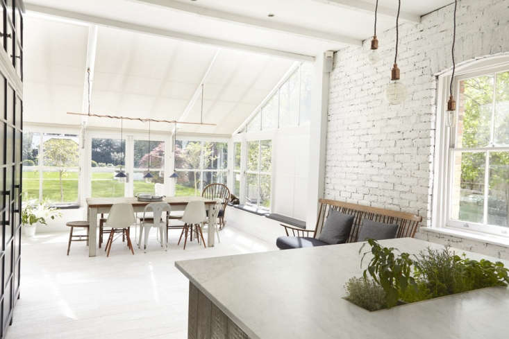 the bright kitchen opens out onto a green backyard in beckenham, on the outskir 9