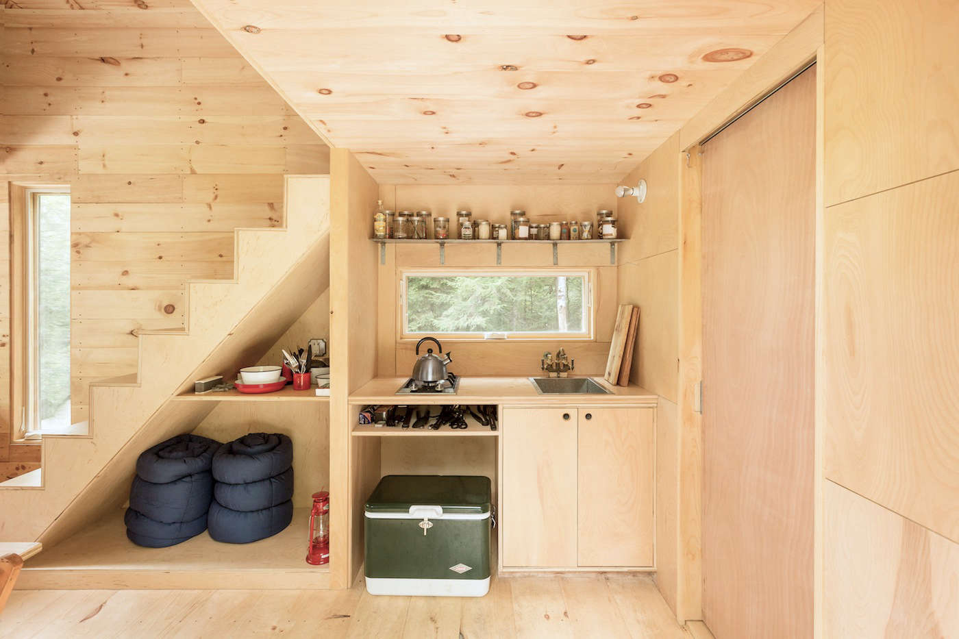 Steal This Look A Stylish Camp Kitchen in a Plywood Summer Cabin A cross section of the cabin kitchen and under stairs storage. Photograph fromGetaway: Instant Camping for the Millennial Set.