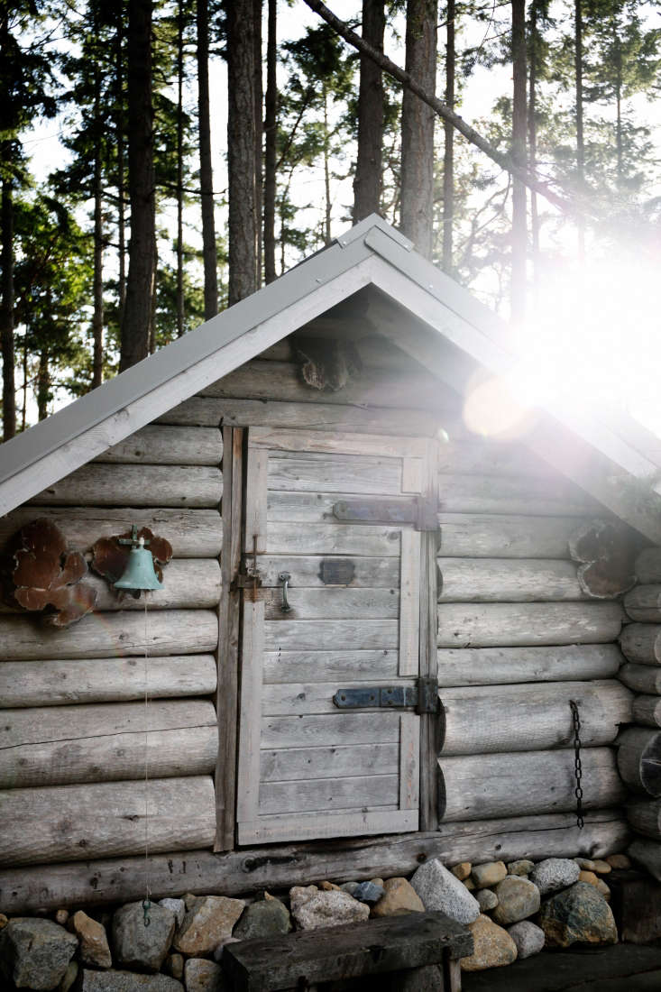 A picturesque shed next to the cabin holds pots for crab boils and other outsized cooking equipment. Kristina rings the bell for her boys at mealtime.