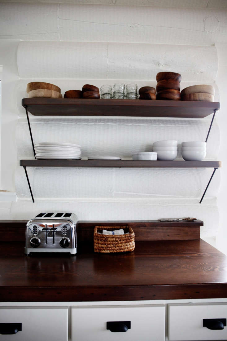 bracketed shelving above a dark wood countertop inkitchen of the week: a whit 16