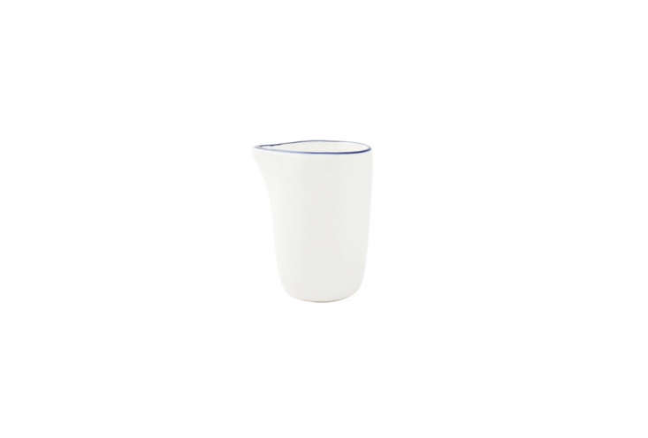 the canvas home abbesses creamer with a blue rim is \$8. 27