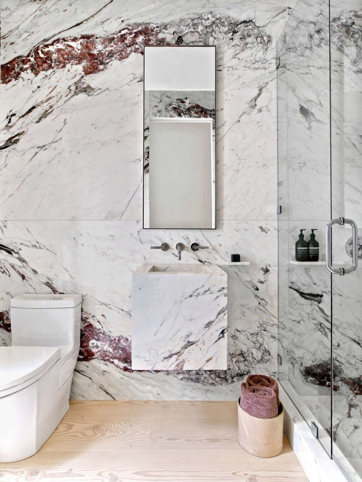 Deep burgundy veining in A Dramatic Marble Powder Room by CCS Architecture, the winner for Best Professional Bath in our Considered Design Awards a few years back. Photograph by Eric Laignel.
