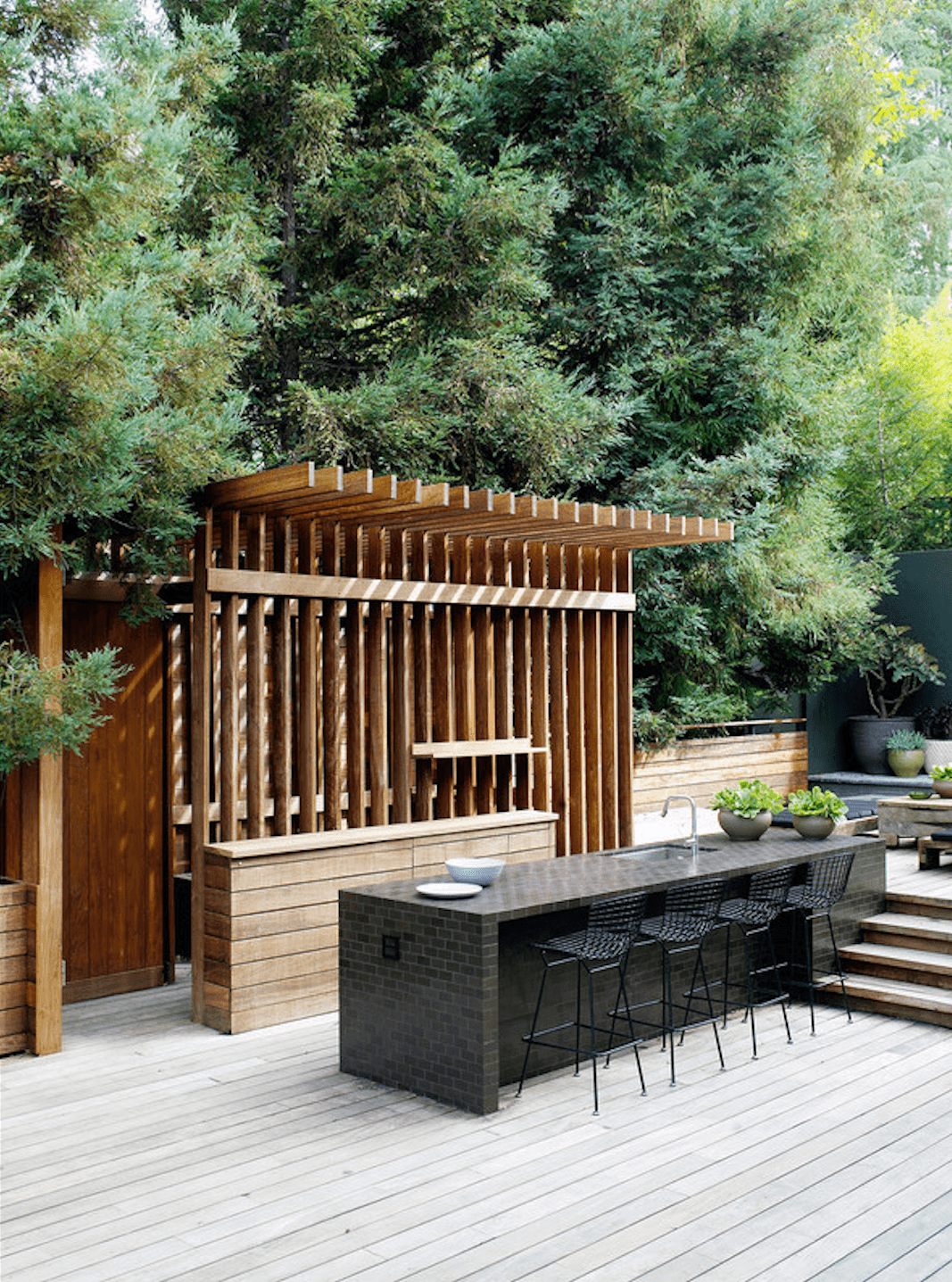 LA design collective Commune created this pergola-like outdoor kitchen in a remodel of a Buff & Hensman house in Los Angeles&#8