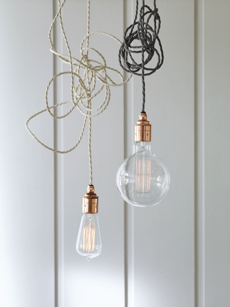 the trio of twisted flex & copper pendant lights hanging over the island ar 19