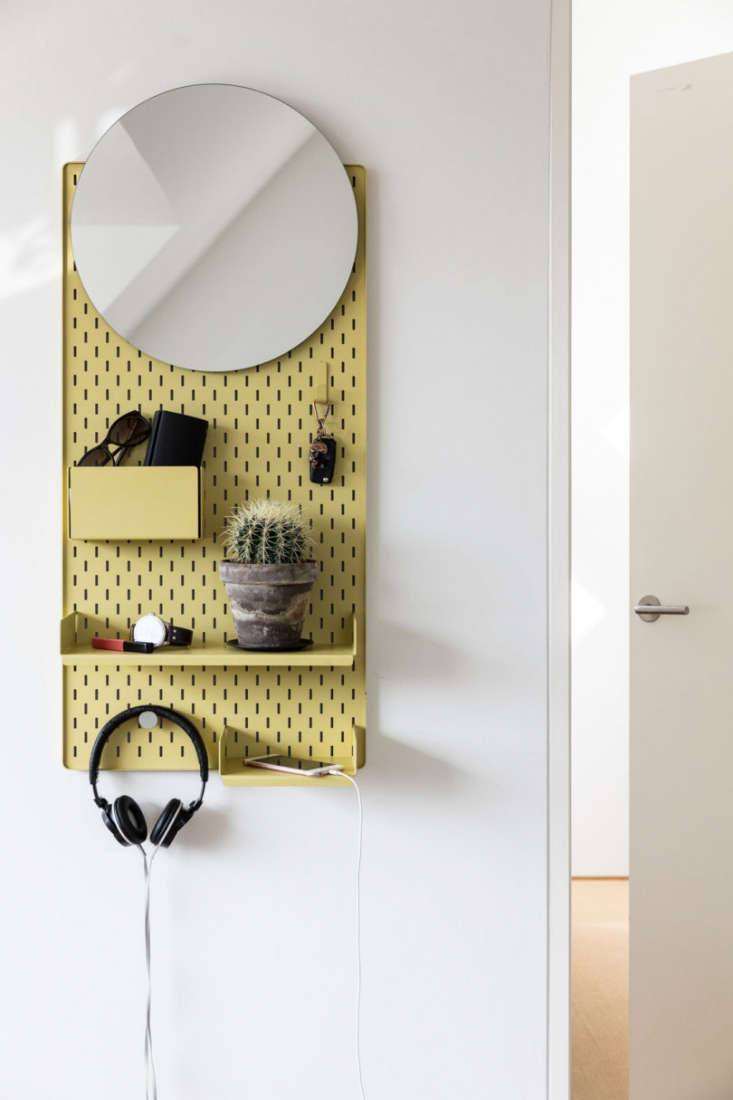 above the all in one shelving unit designed for the entryway, the frameunit i 12