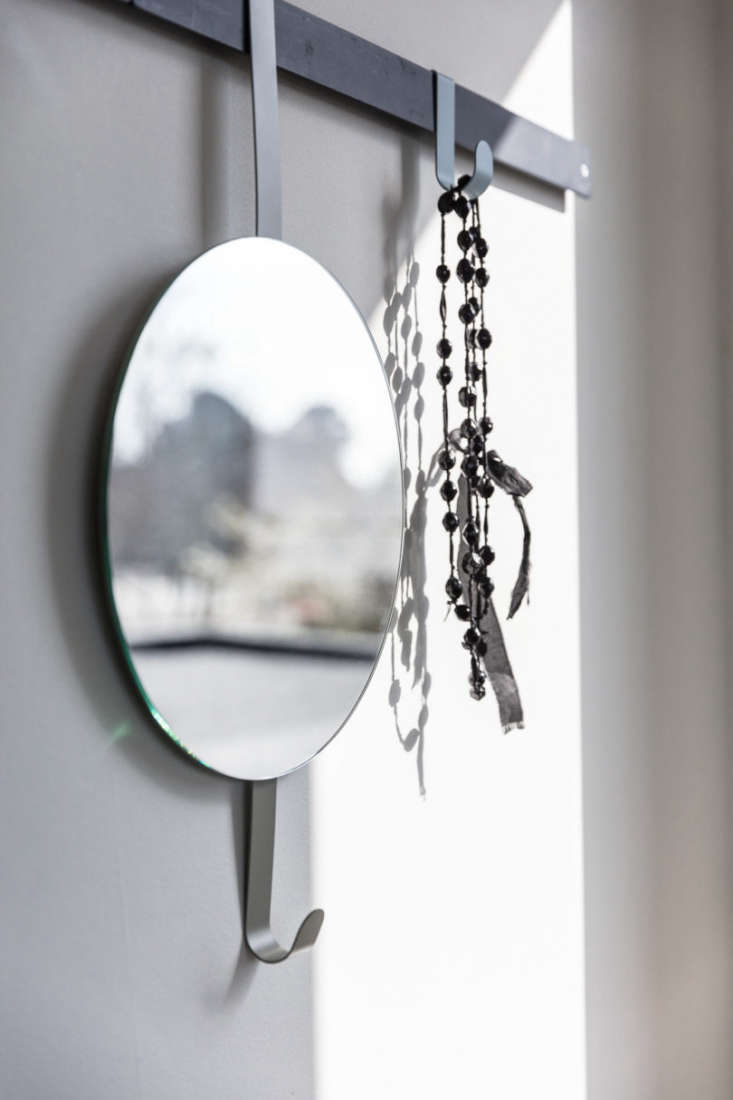 the hexagon mirror is a wall mounted rail with two wall hooks and mirror. 13