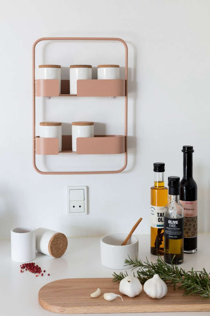 the spice jar rack is available in blush (shown), midnight blue, lemon, and bon 9