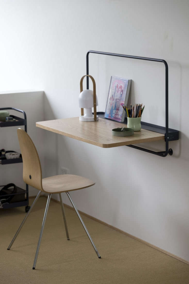 thewall tablefolds up when not in use. it comes in midnight blue (shown) an 14