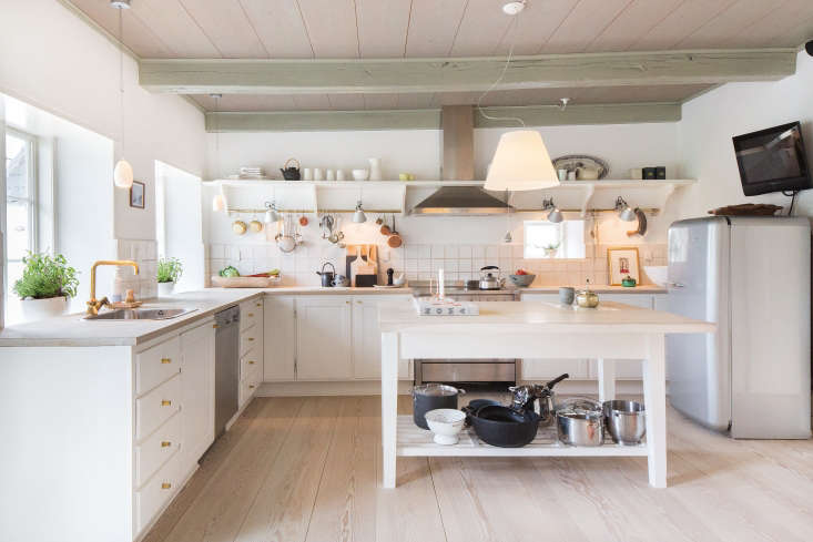 The kitchen was designed by Jørgen Overby's studio, which worked with a local carpenter on cabinetry; the appliances are fromSmeg.