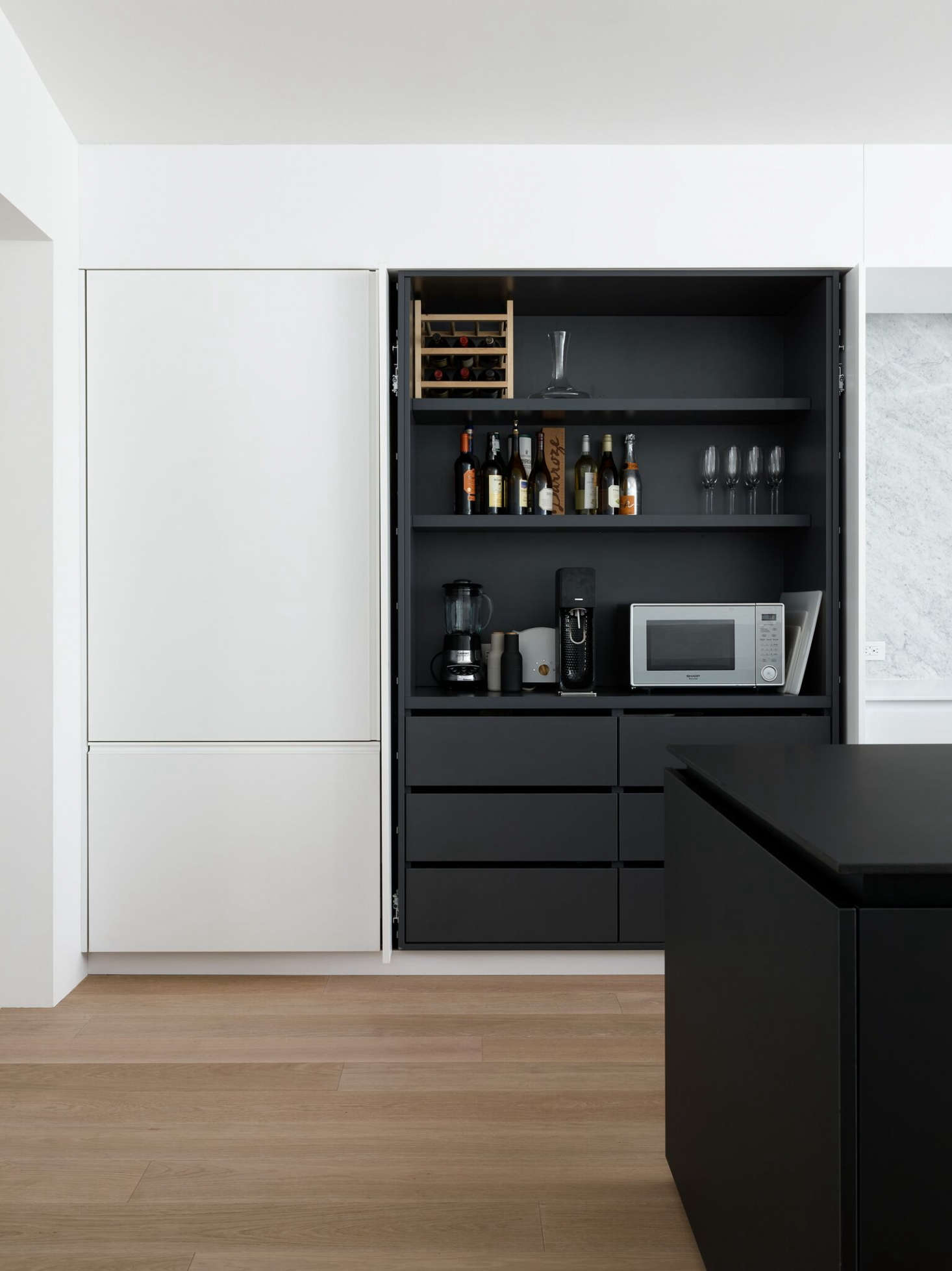 Pocket doors conceal shelving and small appliances in the Noe Valley kitchen of Robert Edmonds and Vivian Lee of Edmonds + Lee Architects.
