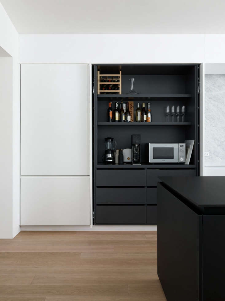 pocket doors conceal shelving and small appliances in the noe valley kitchen of 21
