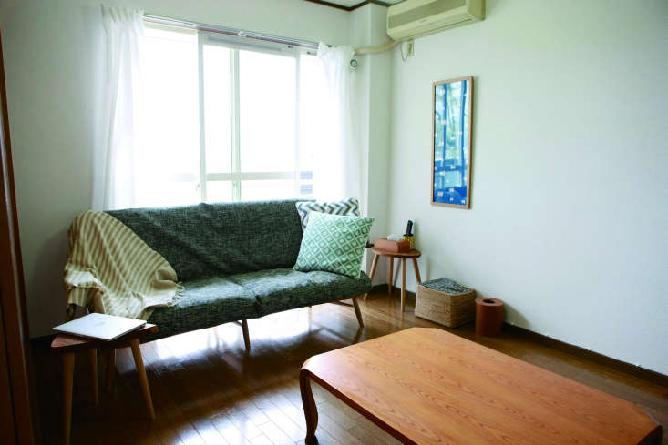 the bare bones living room of a minimalist couple, profiled in the book. 9