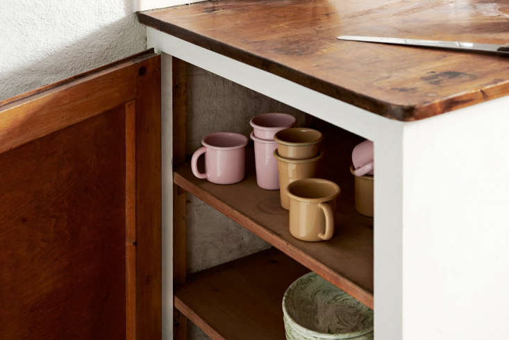 two colors of enamelware cups and mugs. 10