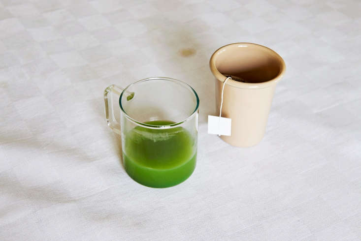 a coffee mug in heat resistant glass and a brown enamel cup. 19