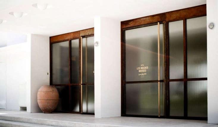 Wide glass doors lead inside.