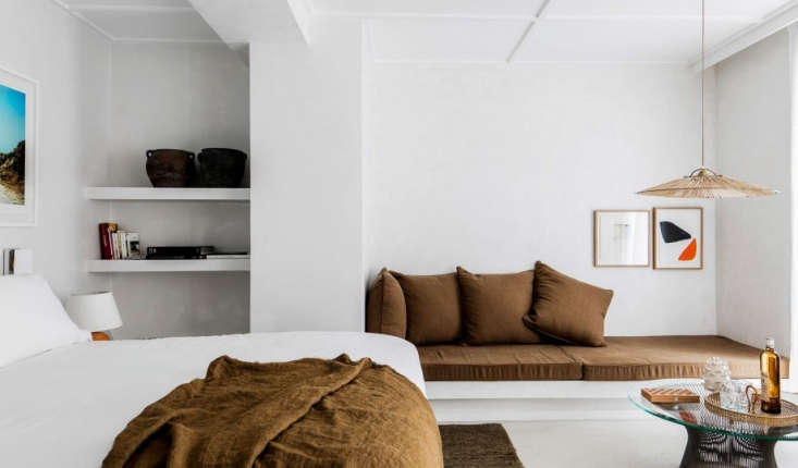 A chaise and throw (from Maison de Vacances) in deeper shades of gold. Throughout the hotel are &#8