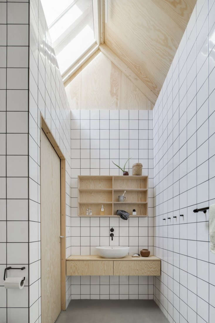 A simple plywood vanity (plus shelves and door) in A Cost-Conscious House in Sweden.