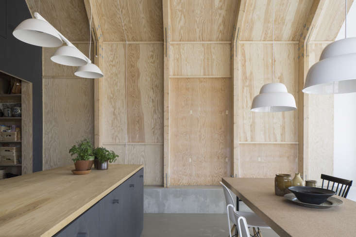 In A Cost-Conscious House in Sweden That's a Pinterest Sensation, nearly everything—including the interior walls, ceilings, and bathroom vanity—is constructed from plywood.