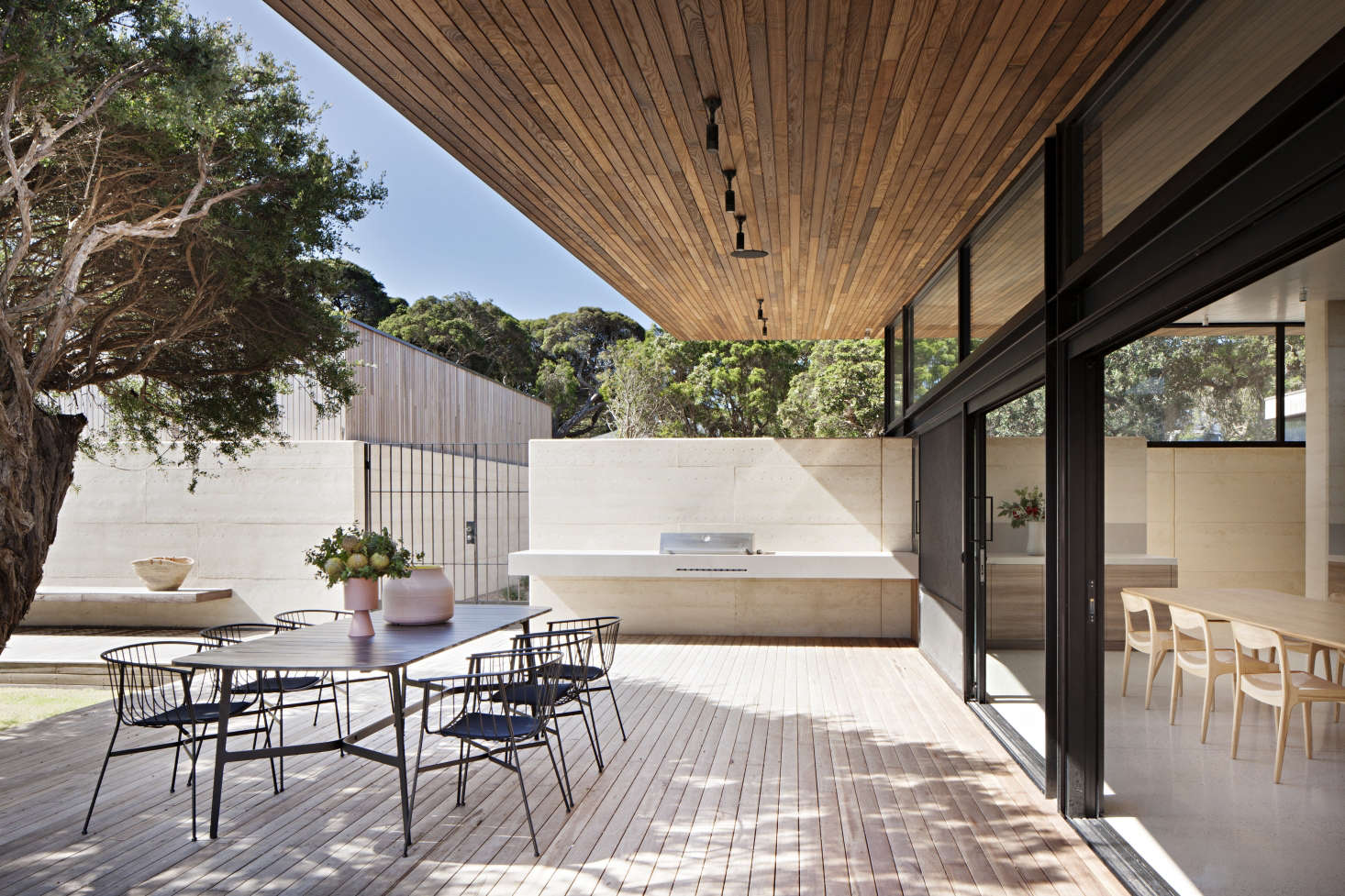 The dining terrace is paneled above and below in spotted gum, an Australian hardwood.