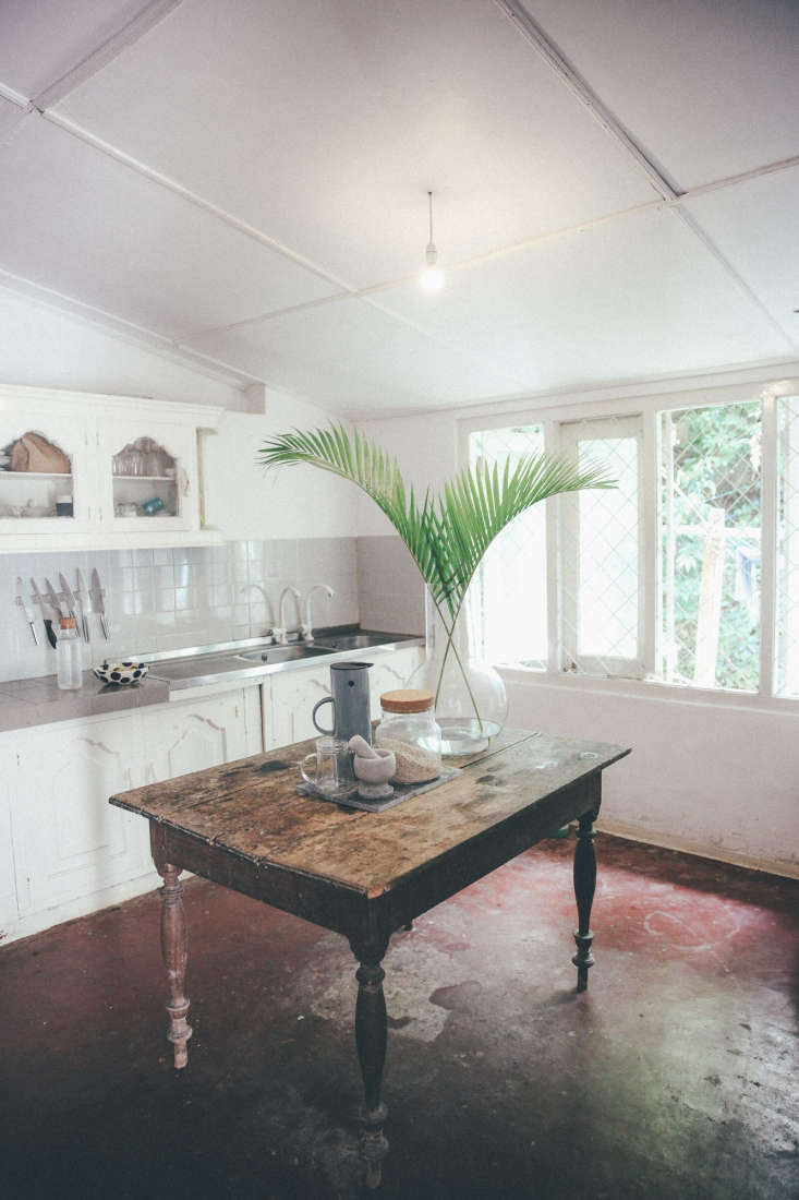 formerly dark brown, the kitchencabinets received a thorough whitewashing as  16
