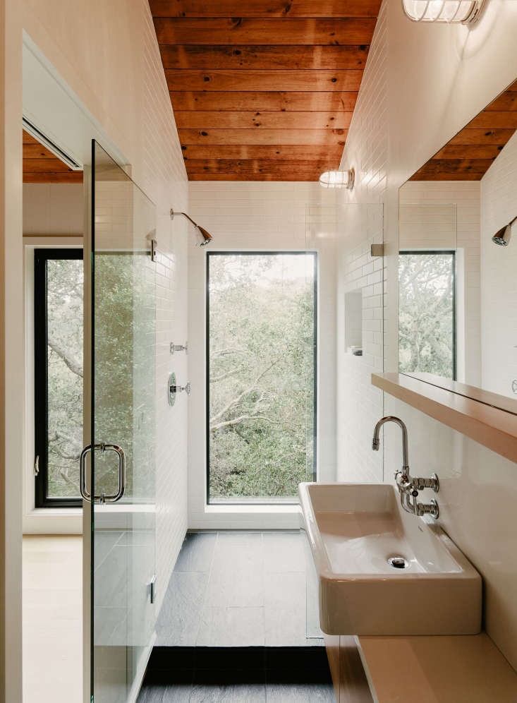 A walk-in shower inCalifornia Idyll: A Pitched-Roof Midcentury Revival with Dramatic Valley Views.